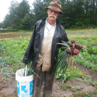 Glen Flett, project manager, with a fresh harvest from Emma's Acres